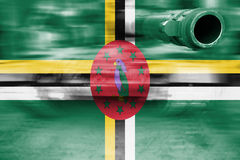 Military strength theme, motion blur tank with Dominica flag Royalty Free Stock Images