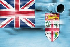 Military strength theme, motion blur tank with Fiji flag Royalty Free Stock Images