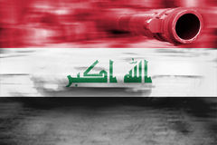 Military strength theme, motion blur tank with Iraq flag Royalty Free Stock Photo
