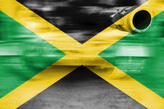 Military strength theme, motion blur tank with Jamaica flag Royalty Free Stock Photo
