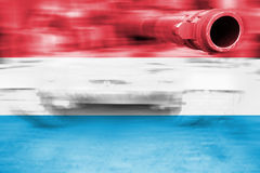 Military strength theme, motion blur tank with Luxembourg flag Stock Image