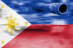 Military strength theme, motion blur tank with Philippines flag Stock Photo