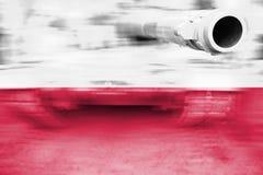 Military strength theme, motion blur tank with Poland flag Stock Photos