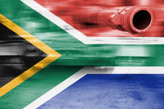 Military strength theme, motion blur tank with South Africa flag Stock Photos