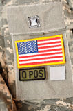 Military stuff 30. US flag, blood type patches on ACU uniform Stock Photography