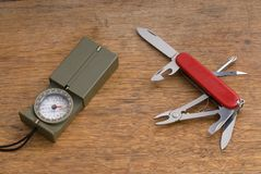 Military Style Compass and Pocket Knife Royalty Free Stock Images