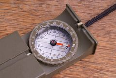 Military Style Compass on a Wooden Table Stock Photography