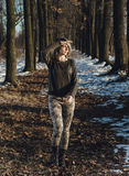 Military style girl in winter forest Stock Image