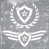 Military style grunge emblems Stock Photography