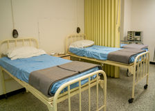 Military style hospital beds. Simple, military style hospital beds from the era of 1940-1960 Royalty Free Stock Photos