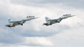 Military Su-30 flying at an airshow Stock Images