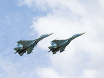 Military Su-30 flying high in the sky Royalty Free Stock Images