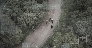Surveillance drone camera view of terrorist squad walking with weapons. Military surveillance drone view of terrorists walking through a forest stock video footage