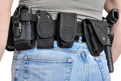 Military tactical belt with semi-automatic buckle for connection with cartridge pouch, placed on man`s belt, isolated - back view.  stock images