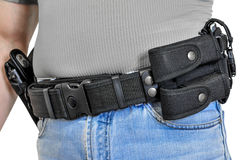 Military tactical belt with semi-automatic buckle for connection with cartridge pouch, placed on man`s belt, isolated - front view Royalty Free Stock Photography