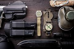 Military tactical equipment for the departure. Assortment of survival hiking gear