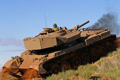 Military tank. A military tank in action over rough terrain Royalty Free Stock Photo