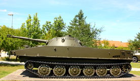 Military tank. A military green old tank outdoor in a park Stock Image