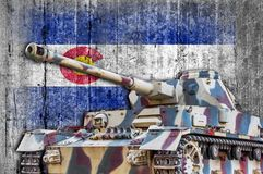 Military tank with concrete Colorado flag. Armored army attack vehicle stock photography