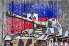 Military tank with concrete Haiti flag. Armored army attack vehicle stock photography