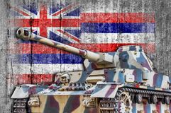 Military tank with concrete Hawaii flag. Armored army attack vehicle royalty free stock photography