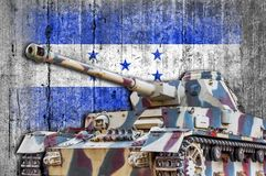 Military tank with concrete Honduras flag. Armored army attack vehicle stock images