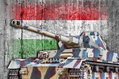 Military tank with concrete Hungary flag stock image