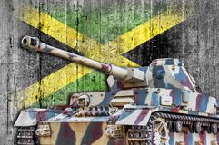 Military tank with concrete Jamaica flag. Armored army attack vehicle Royalty Free Stock Photo