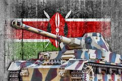 Military tank with concrete Kenya flag royalty free stock photography