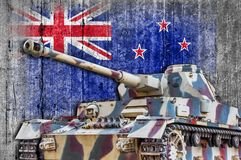 Military tank with concrete New Zeland flag stock image