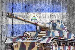 Military tank with concrete Nicaragua flag. Armored army attack vehicle royalty free stock photography