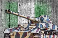Military tank with concrete Nigeria flag stock photo