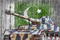 Military tank with concrete Pakistan flag. Armored army attack vehicle Royalty Free Stock Photo
