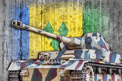 Military tank with concrete Saint Vincent and the Grenadines flag. Armored army attack vehicle Stock Photo