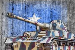 Military tank with concrete Somalia flag. Armored army attack vehicle stock images
