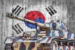 Military tank with concrete South Korea flag. Armored army attack vehicle royalty free stock images