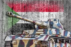 Military tank with concrete Sudan flag royalty free stock image