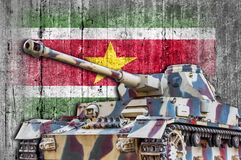 Military tank with concrete Suriname flag. Armored army attack vehicle Stock Photos