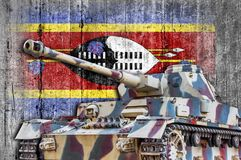 Military tank with concrete Swaziland flag stock image