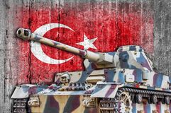 Military tank with concrete Turkey flag. Armored army attack vehicle royalty free stock photo