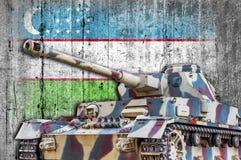 Military tank with concrete Uzbekistan flag stock photo