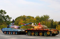 Military tank painted in colorful flowers Royalty Free Stock Photos