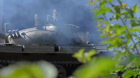 Military tank on smoke background standing on war field slow motion. Military tank on smoke background standing on war field. Slow motion smoke from war tank on stock video