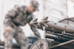 Military tank and soldier, Troops prepare equipment. Stock Photography