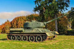 Military tank. A military tank stationed in front of the woods royalty free stock photos
