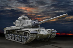 Military Tank. With sunset skies in background Royalty Free Stock Photos