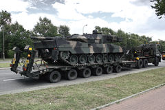 Military tank on trailer Stock Photo