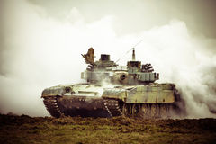 Military tank on war. Heavy military tank in the field of battle - mission in dust and smoke