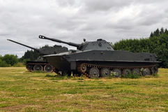 Military tanks. Two military tanks sitting in a field stock photos