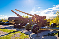 Military tanks and cannons with sun rays Royalty Free Stock Photography